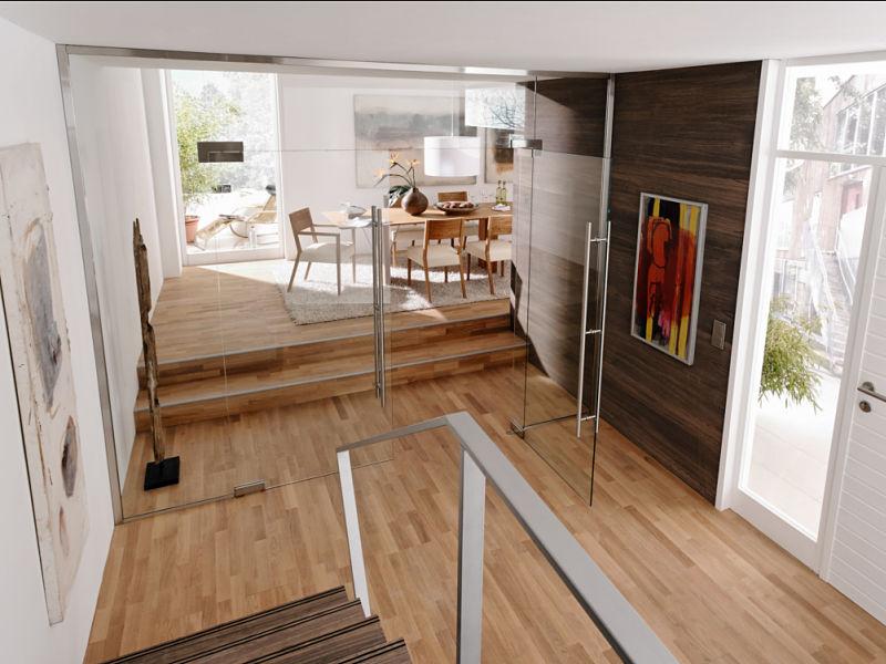 Moderner Raumteiler aus Klarglas mit einer doppelflügligen Drehtür