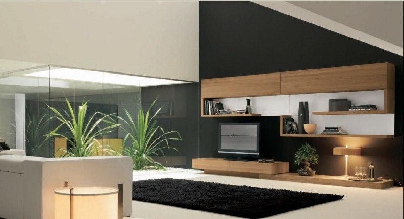 Große Glasflächen geben diesem Designer-Wohnzimmer einen ganz besonderen Charme