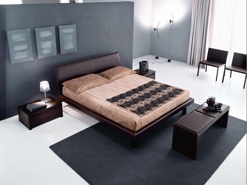 Schlafzimmergestaltung mit Möbeln in dunklem Leder
