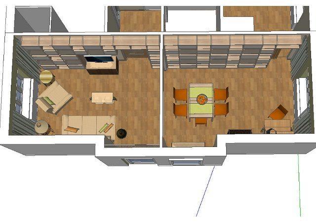 Für die seitliche Wand des Wohnzimmers entwarfen wir ein Bücherregal, das sich über die gesamte Wandlänge erstreckt.